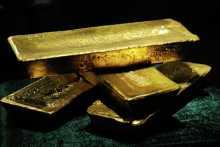 Цены на золото снизились вторую сессию подряд впервые за май