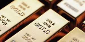Фьючерсы на золото закрылись на девятимесячном минимуме